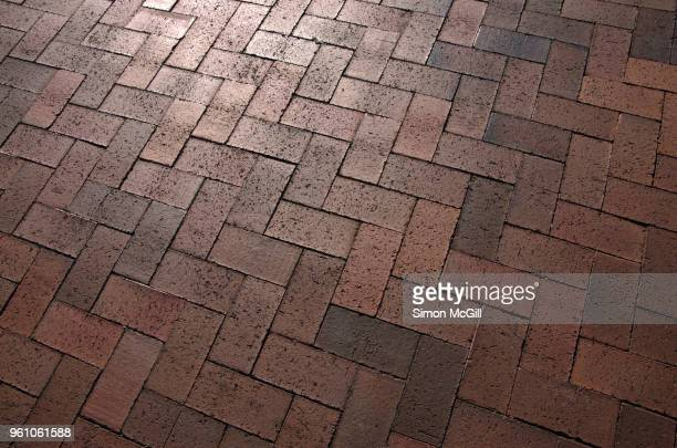 brick paving in a zigzag pattern on a driveway - paving stone stock pictures, royalty-free photos & images