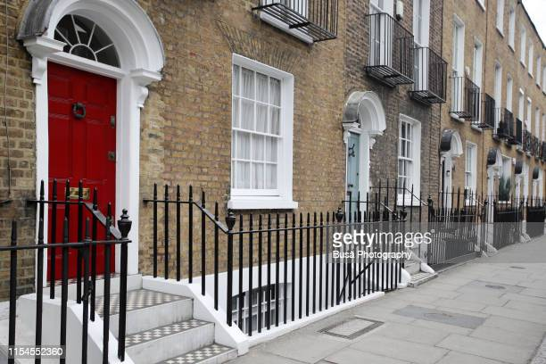 brick rowhouses in london, england - wealth stock pictures, royalty-free photos & images