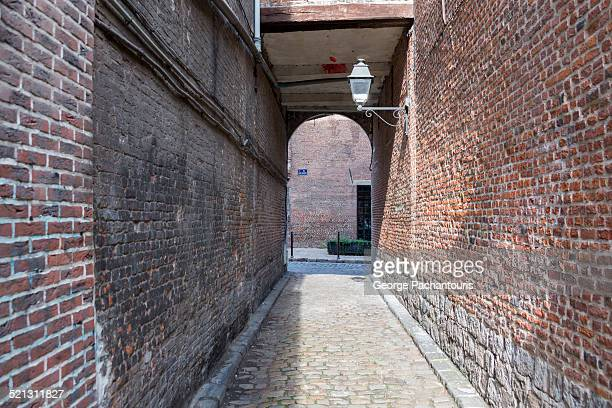 Brick wall and arch in Lille