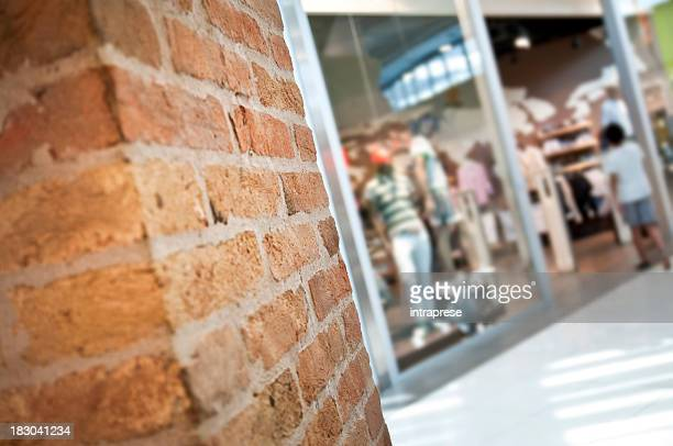 brick wall and reatil window - cement stock pictures, royalty-free photos & images