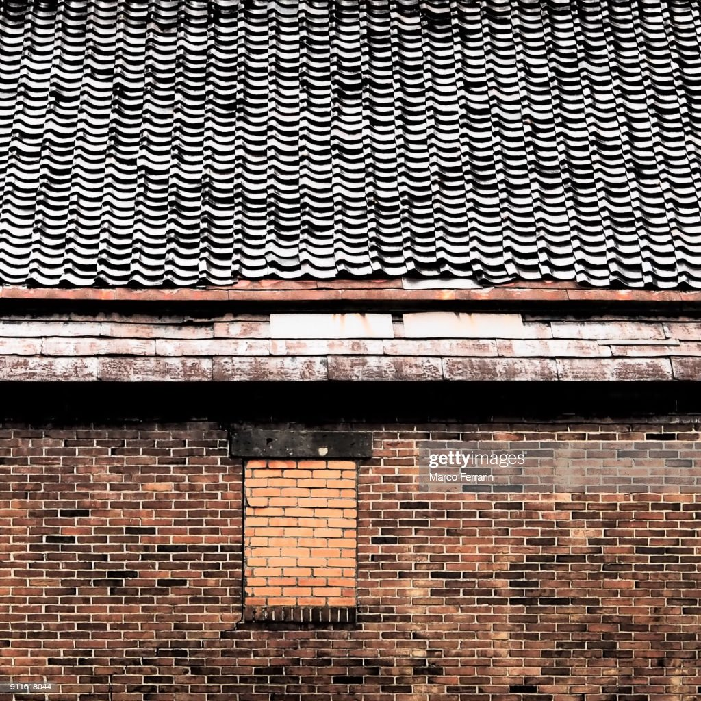 Brick Wall And Roof Tiles Of Warehouse Stock Photo - Getty Images