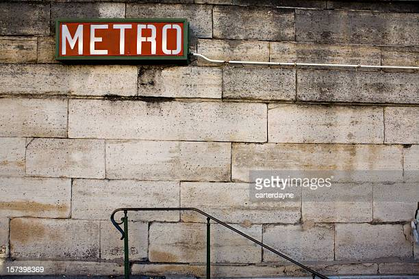 brick wall and slope with a red metro sign on top - paris metro sign stock pictures, royalty-free photos & images