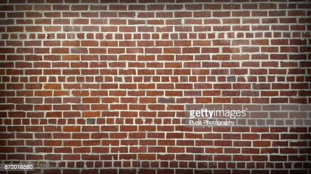 brick wall in manhattan, new york city - brick wall stock pictures, royalty-free photos & images