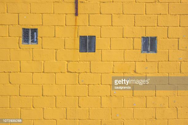 Brick wall painted in yellow