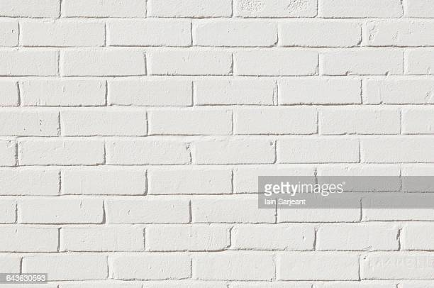 Brick wall painted white.