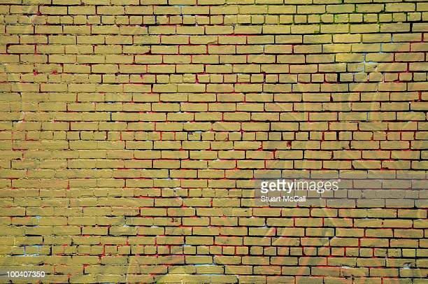 Brick wall, recently painted to cover graffiti