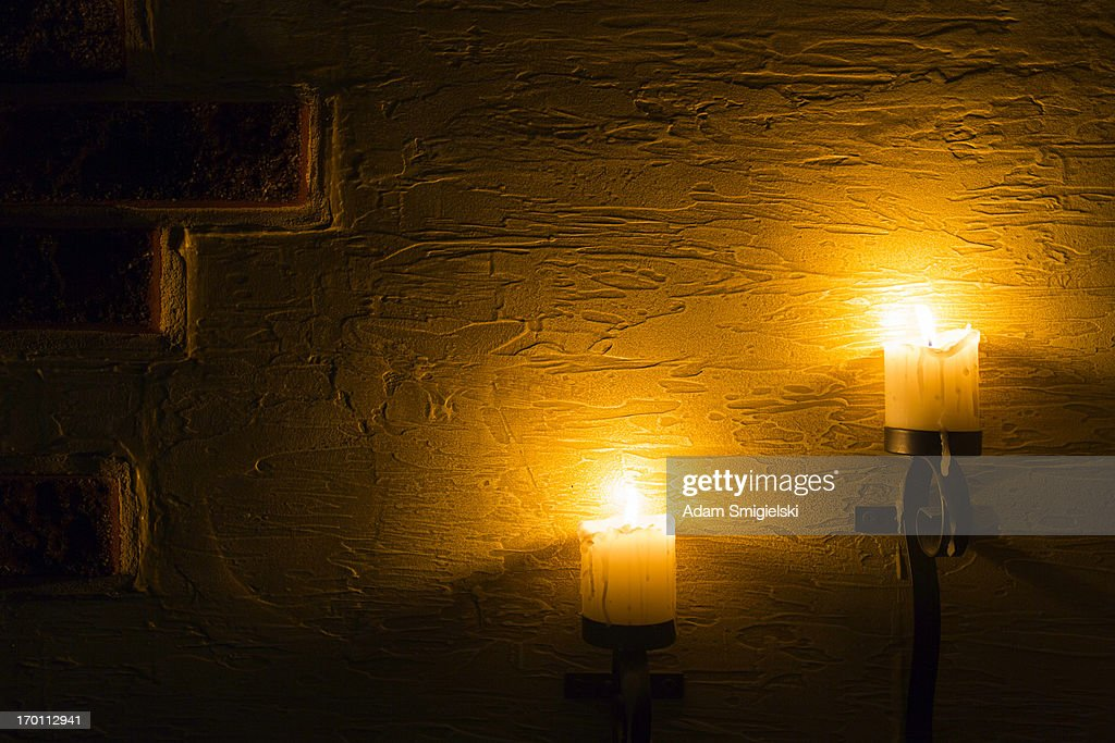 brick wall with candles : Stock Photo