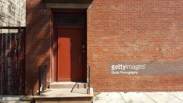 Brick wall with entrance door in Brooklyn, New York City