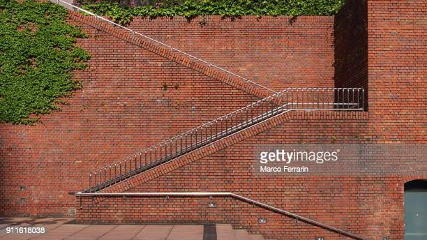Brick Wall with Ivy and Railings in Tokyo