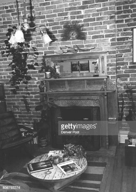 Brick Wood Exposed Several layer of paint were scraped to reveal moldings tiles on cherry fireplace Credit Denver Post Inc