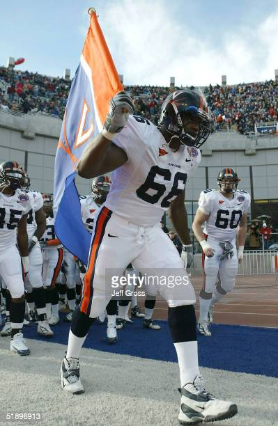 Brickashaw Ferguson of Virginia leads his team on to the field against Fresno State prior to the start of the MPC Computers Bowl on December 27 2004...