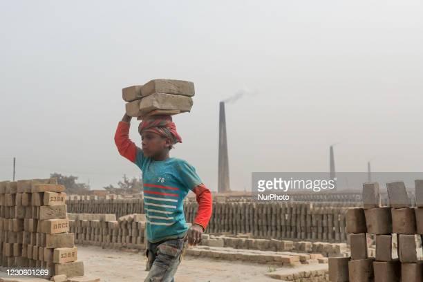 Brickfield children workers are work in brickfields at Narayanganj near Dhaka Bangladesh on January 15, 2021.
