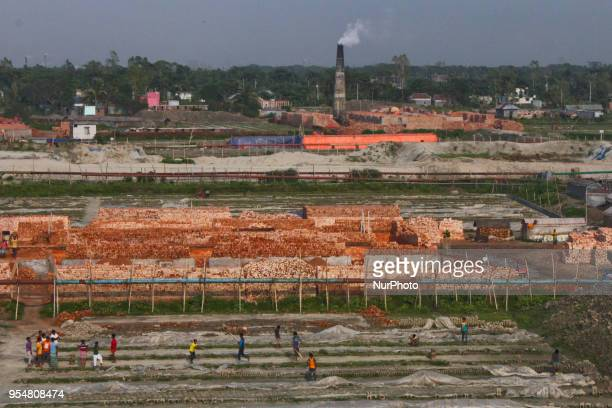 Brickfield workers playing cricket after finish their days work at their brickfield in Dhaka Bangladesh on May 4 2018