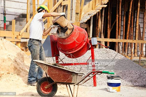 bricklayer and concrete mixer - wheelbarrow stock pictures, royalty-free photos & images