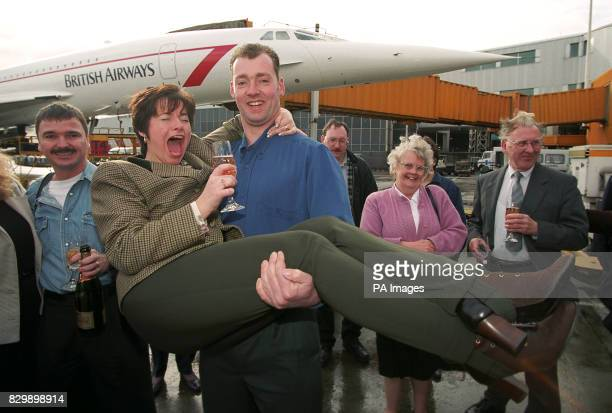Bricklayer Gary Foss lifts his girlfriend Sarah Jane Smith as they join the first group of winners of 10 tickets for a British Airways Concorde...