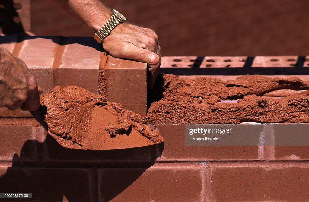 Bricklayer Holding Trowel Building Wall Close Up Of Hands Stock Photo