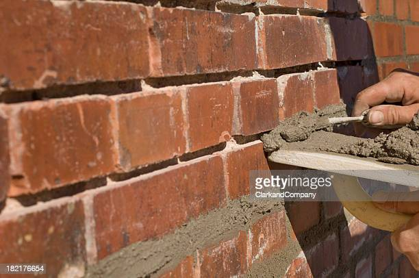 Bricklayer Repointing Old Bricks
