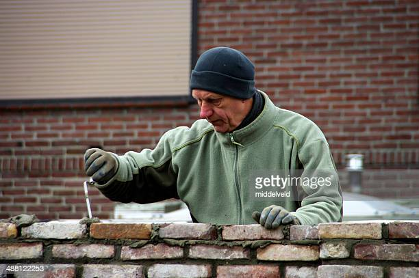Bricklayer working on an wall