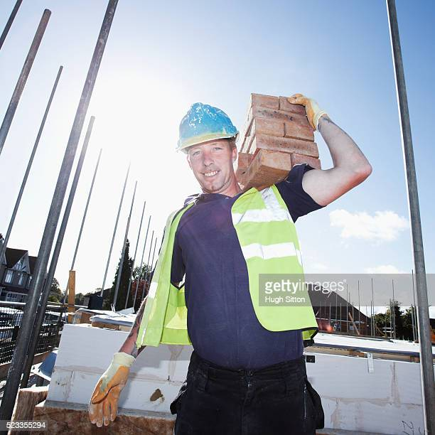 bricklayer working on construction site - hugh sitton stock pictures, royalty-free photos & images