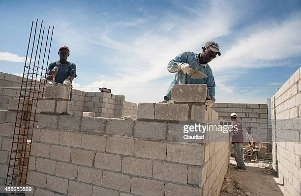 Bricklayers building a new house