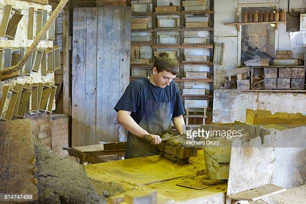 brickmaker making hand thrown brick - richard drury stock pictures, royalty-free photos & images