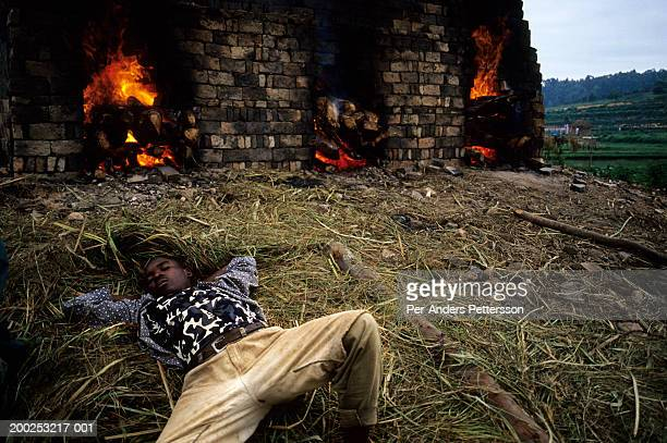A brickmaking factory worker takes a nap early in the morning as he has worked the whole night keeping a fire alight on February 14 2003 About 100000...