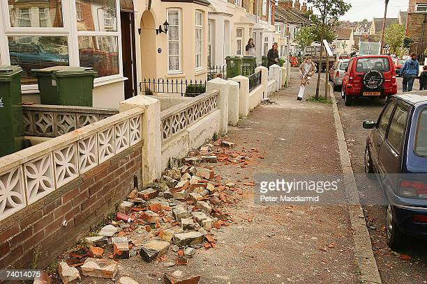 Bricks and debris from damaged chimneys are scattered across the pavement after an earthquake caused damage to houses on April 28, 2007 in Folkstone,...