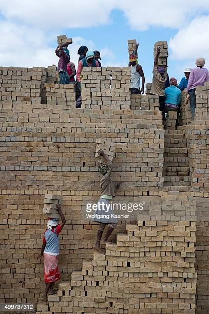 Bricks made out of clay are being stacked to be burned near Antananarivo the capital city of Madagascar