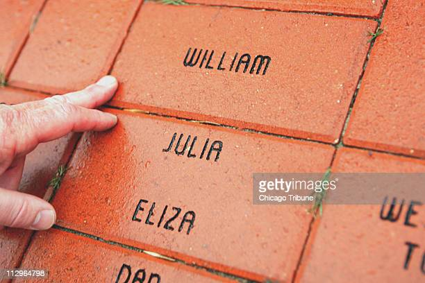 Bricks near the statue of Julia Dent Grant in Galena Illinois memorialize the family's slaves but a statue committee would not let the word slave...