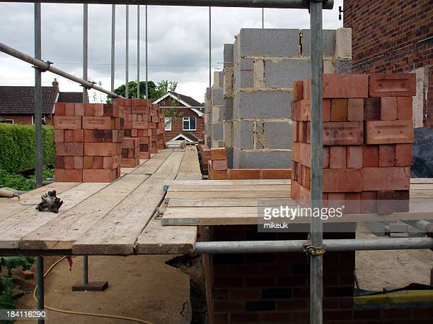 bricks on scaffolding for wall construction