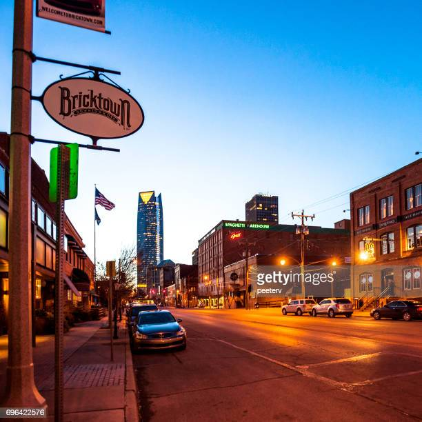 bricktown - oklahoma city by night - oklahoma city stock pictures, royalty-free photos & images