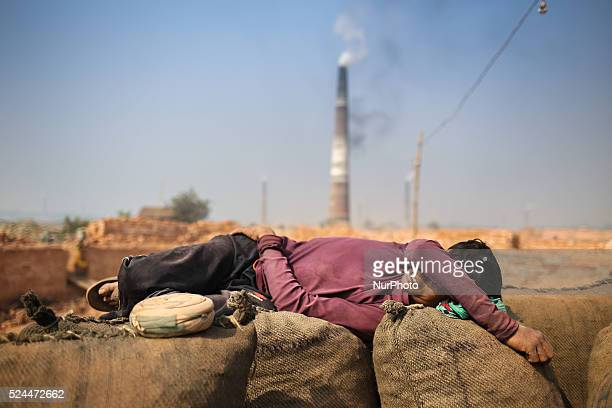 Brickyard worker is taking a shot nap during work The world is going through a speedy urbanization and Bangladesh is not an exception from this Such...
