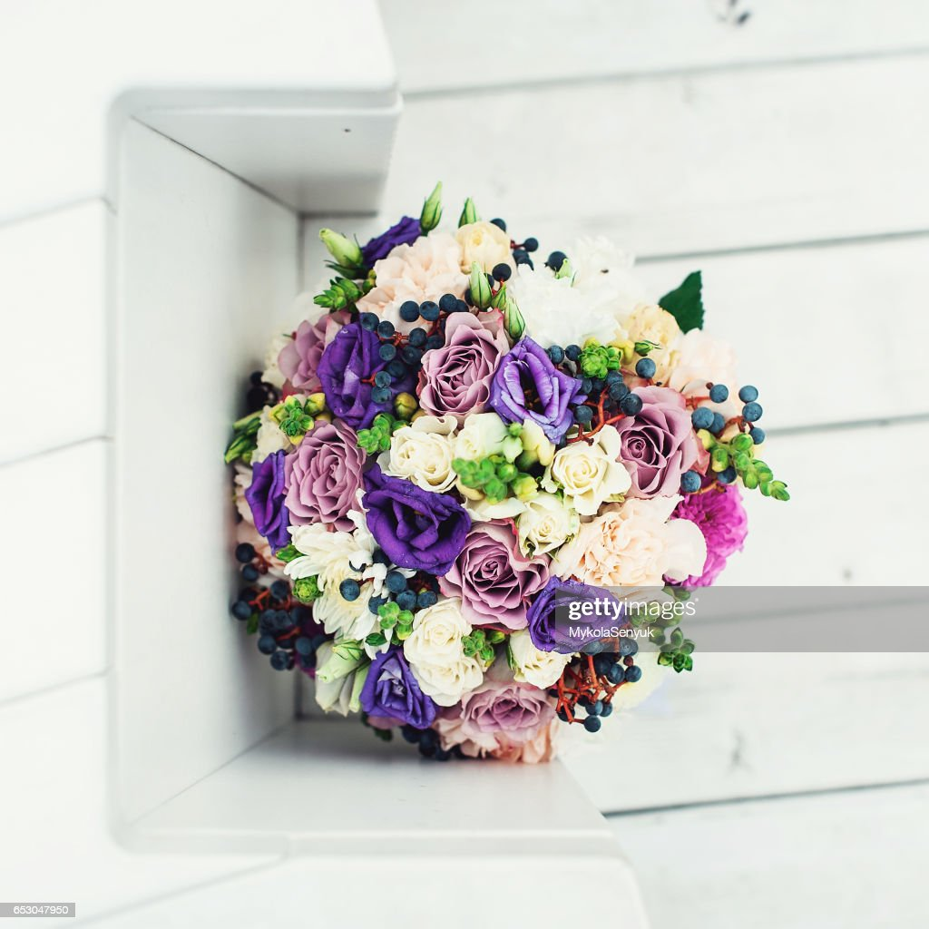 Bridal bouquet of different flowers wrapped lace ribbon on a white bridal bouquet of different flowers wrapped lace ribbon on a white background stock photo izmirmasajfo