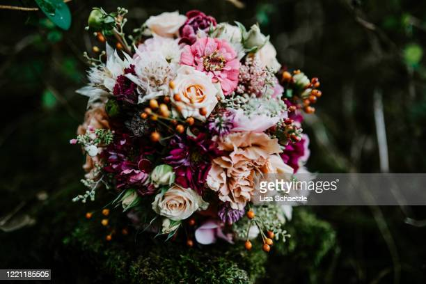 bridal bouquet with pink, red and orange flowers - flower arrangement stock pictures, royalty-free photos & images