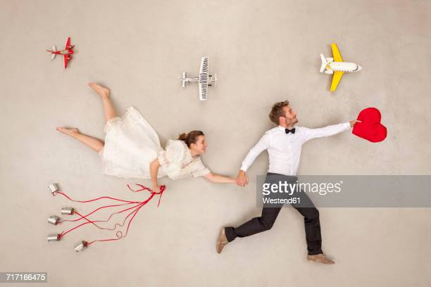 bridal couple going on honeymoon - honeymoon stock pictures, royalty-free photos & images
