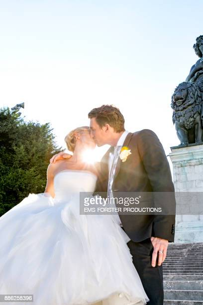 bridal couple kissing and the sun hits the lens