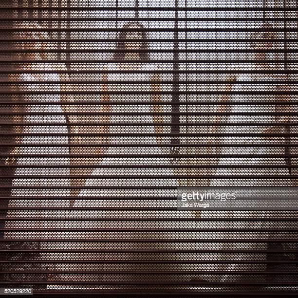 bridal dress shop locked up for the night, stockholm, sweden - jake warga stock pictures, royalty-free photos & images