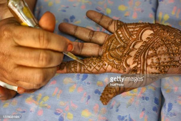 Bridal henna is applied to the hands and feet of a Hindu bride the night before her marriage in Thiruvananthapuram , Kerala, India, on February 05,...