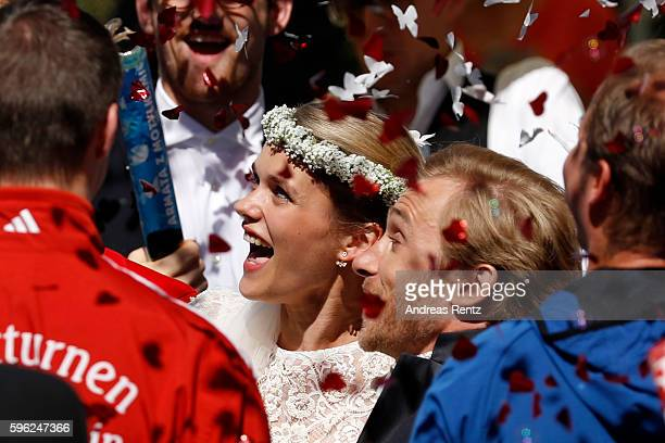 Bridal pair Samuel Koch and Sarah Elena Timpe get cheered on by their guests after their wedding ceremony at the local church on August 27 2016 in...