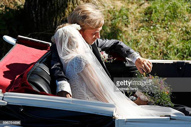 Bridal pair Samuel Koch and Sarah Elena Timpe ride a carriage after the wedding at the local church to go to their party on August 27 2016 near...