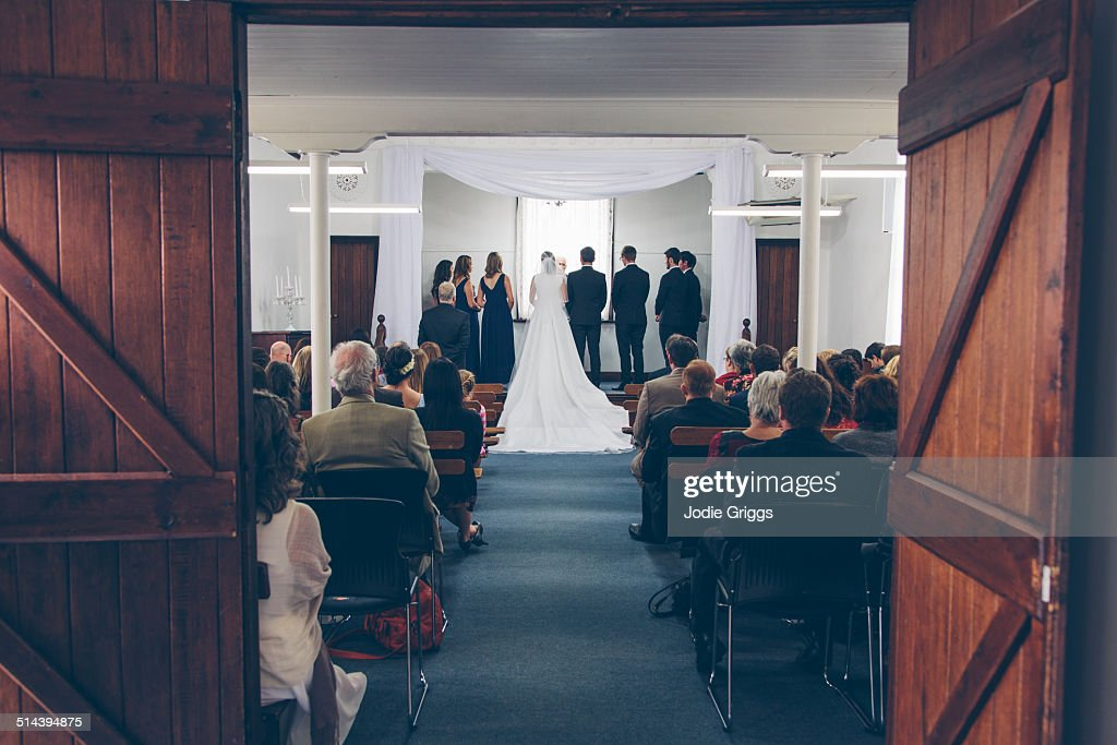 Bridal Party standing on stage in small hall : Stock Photo
