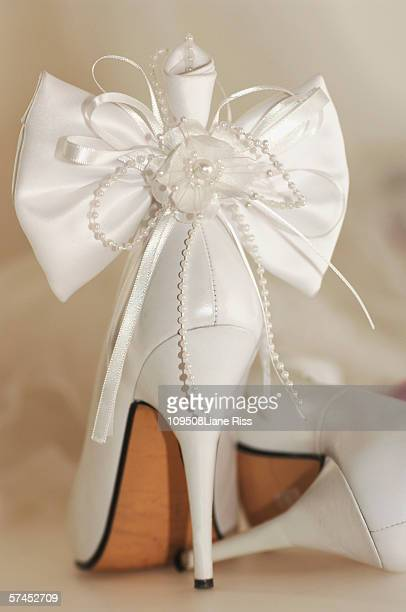 bridal shoe tied with ribbon - bound in high heels stock photos and pictures