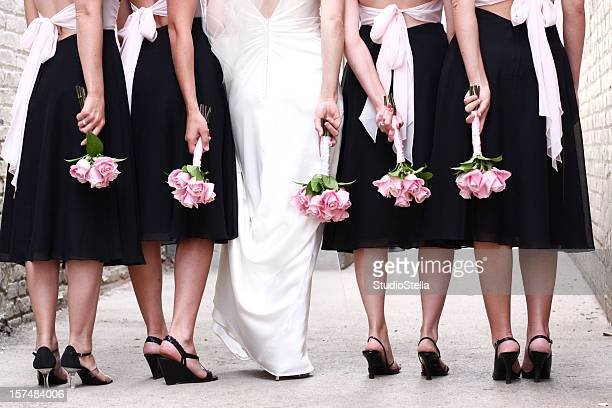 Bridal Wedding party with pink rose bouquets
