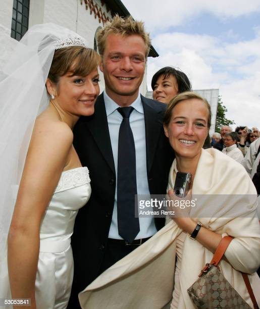 Bride Alexandra Stich Oliver Geisen TVModerator and his wife Ulrike poses for photograph at the Sankt Severin church on June 11 2005 at Sylt in...