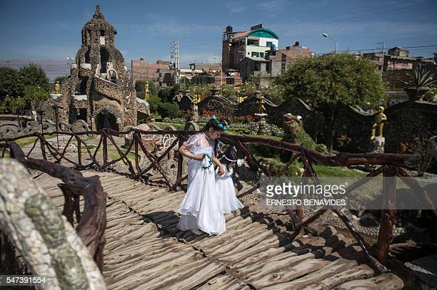 TOPSHOT A bride and a little girl visit the Huanca Identity Park in the city of Huancayo 376 km east of Lima on June 25 2016 The Huanca Identity Park...