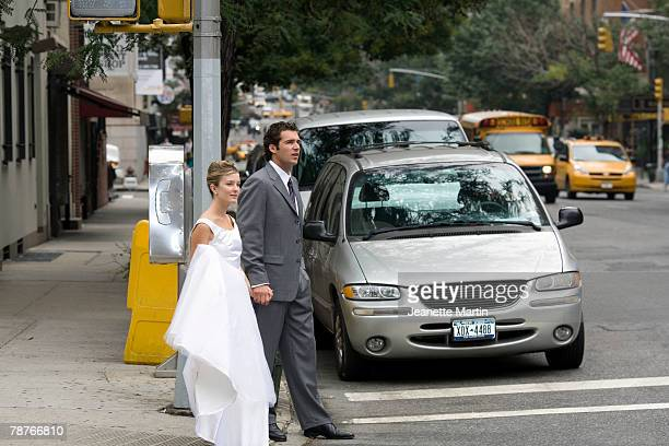 A bride and bridegroom crossing the street