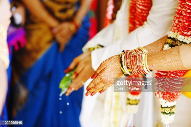 Bride And Bridegroom With Hands Cupped During Wedding Ceremony