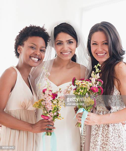 bride and bridesmaids holding bouquets of flowers - bridesmaid stock pictures, royalty-free photos & images