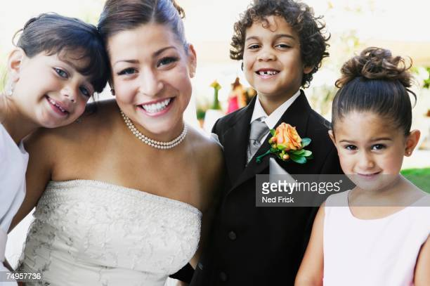 Bride and children hugging
