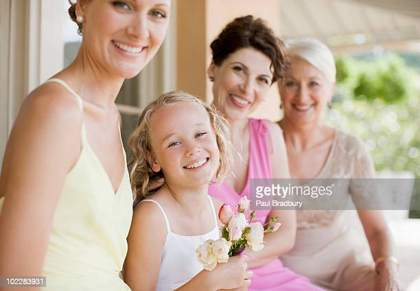 Bride and family smiling at wedding reception